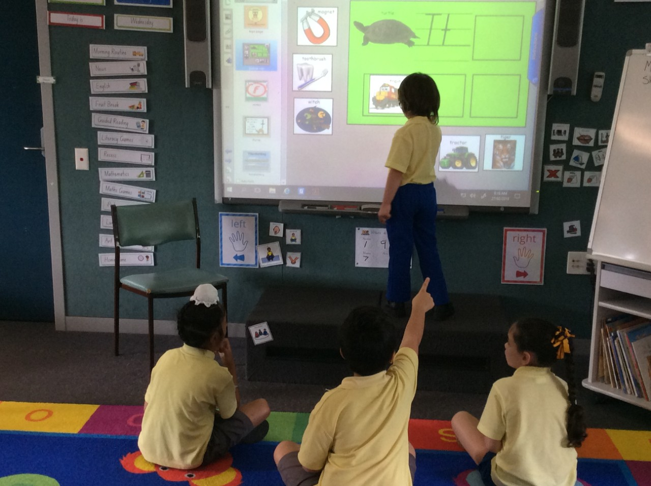 Students using the interactive whiteboard